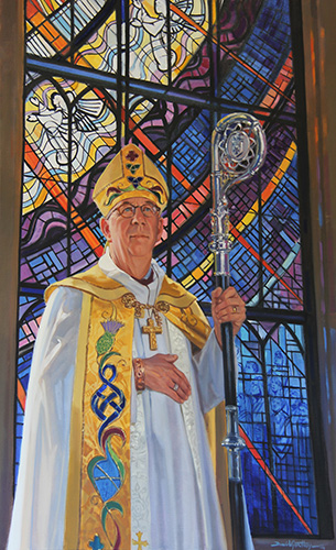 Portrait of Bishop Logan McMenamie in front of stained glass