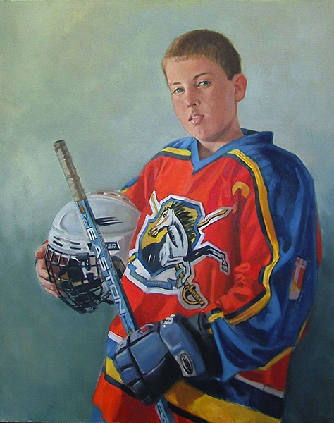 Portrait of boy in hockey gear