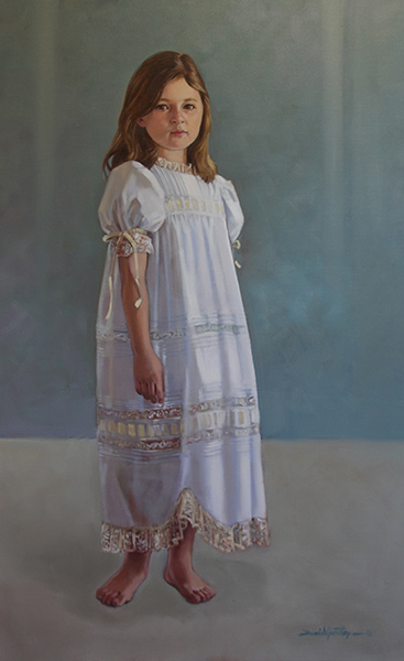 Portrait of girl standing in white dress