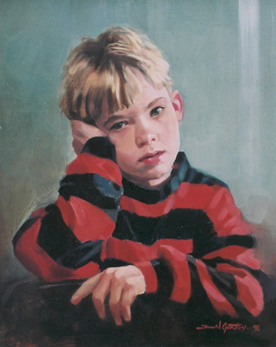 portrait of boy in striped shirt