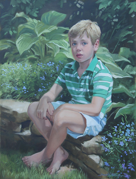 Portrait of boy in garden