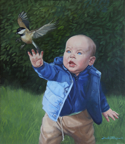 Portrait of baby and bird