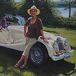 Portrait of woman with her classic car