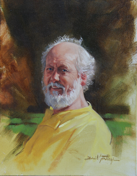 Portrait of man in yellow shirt
